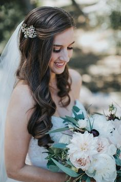 Natural wedding hair idea for bride - loose curls with half-up in wax flower clip {Michael Stephens Photography}