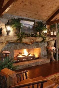 LOVE a split-log mantel on a stone fireplace in a rustic cabin . looks nice wi. LOVE a split-log mantel on a stone fireplace in a rustic cabin … looks nice with carriage lights Rustic Fireplaces, Cabin Fireplace, Fireplace Design, Fireplace Ideas, Stone Fireplaces, Indoor Fireplaces, Country Fireplace, Basement Fireplace, Fall Fireplace