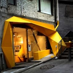Hong Kong's new concept store, Konzepp, is full of freakishly fun little gadgets and trinkets. To complement the stores selection, designer Geoff Tsui, co-founder of design firm 33WILL, created an angular and twisted bright yellow facade.