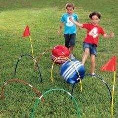 Kick croquet using half hula hoops for rings.