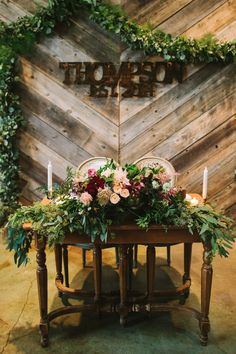 Rustic, urban, COLORFUL sweetheart table overflowing with flowers | Let's Frolic Together