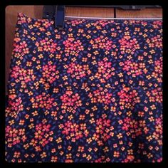 Navy, orange, coral floral print skirt Navy skirt with orange and coral floral print. Knit material with foldover waist to length and easily be adjusted to fit your style! torrid Skirts Pencil