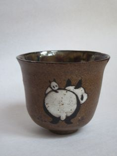 Panda teabowls come with mama panda and baby. Brushpainted high fire stoneware.