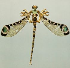 Corsage Ornament, Rene Lalique, French 1897-98. Gold, enamel, chrysoprase, moonstones, and diamonds.Calouste Gulbenkian Museum, Lisbon. From the Book: Jeweled Bugs & Butterflies by Rilyn Nissenson & Susan Jonas/Abrams