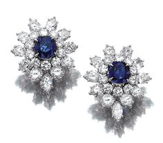 SAPPHIRE AND DIAMOND EAR CLIPS, HARRY WINSTON set at the centre with a cushion-shaped sapphire within a cluster surround of pear-shaped and brilliant-cut stones, mounted in platinum, numbered, maker's marks for Jacques Timey, who worked for Harry Winston.