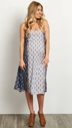 This flowy maternity dress is perfect for keeping you cool when the weather gets warm. A trendy tribal print looks great paired with strappy sandals and a long necklace. You will love the look and feel of this dress from morning until night.