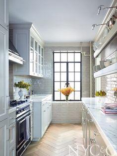 White oak herringbone floors in an all-white kitchen with subway tile and marble countertops. #NYC&G #Herringbone #Marble
