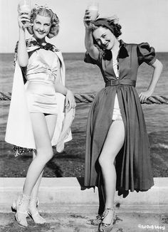 The best part of waking up....Mimosas in your cup. Anita Louise and Olivia de Havilland, 1937.