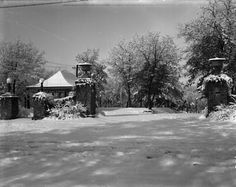Irvine Park Station circa 1900. The inter-urban street car terminal station shelter at Irvine Park. A heavy snowfall covers the landscape. A stone wall gateway with lampposts and decorative urns is in front of the station. Still at Irvine Park today. Courtesy of the Wisconsin Historical Society.