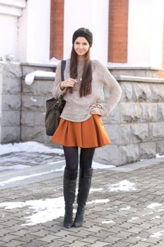 long, open-knit sweater with a shorter skirt and boots.  I LOVE this.  I don't think it looks as good on me as it does on her...