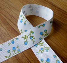 3 meters of 25 mm Grosgrain Ribbon with Blue Flowers