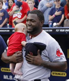 Twitter / MLB: Why yes, @ David Ortiz did decide to hold an infant during the National Anthem. - a fan requested Ortiz hold the baby for a photo and the National anthem started. So he did the natural thing. He held the baby & saluted the Flag. Go, Big Papi : )