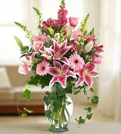 Brighten their day w/a vibrant design of stargazers, roses, gerbera & other spring flowers!