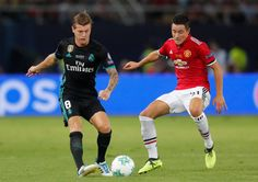 Toni Kroos of Real Madrid and Ander Herrera of Manchester United battle for possession during the UEFA Super Cup final between Real Madrid and...