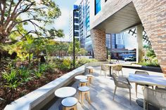 Aurizon, 900 Ann Street | Penfold Projects Hedges Landscaping, Landscaping Work, Landscape Maintenance, Anglican Church, Cozy Cafe, Tower Building, Relaxing Places, Roof Design, Tropical Plants