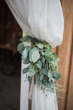 Seeded eucalyptus (sage color) with draped fabric - organic, airy and beautiful decor for a winter wedding! {Conforti Photography LLC}