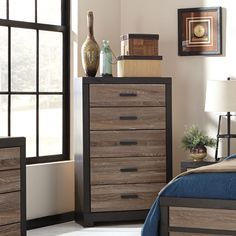 Bring style and elegance to your room with this two-tone modern look. The Harlinton five drawer gray 5 drawer chest from Ashley Furniture makes this chest of drawers as durable and functional as it is beautiful.