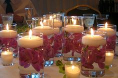 Inexpensive way to decorate! Flowers in a cup with floating candles!