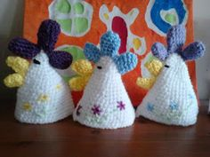 Cute crochet egg cosies with link to free pattern