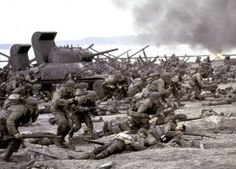 D Day June 6, 1944. This is a picture where the U.S. soldiers were actually on the beach rushing towards Germany on foot.