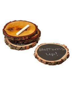 Reversible Wood Coasters With Soapstone Chalk: Decorate the mini-blackboard side of this set with the guzzler's name or drink of choice. If you prefer a more natural look, flip the coaster over for a woodgrain design.