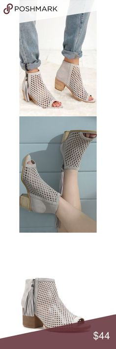 """✨JUST IN✨ Grey perforated peep toe booties ✨JUST IN✨ Grey perforated peep toe booties. This one of a kind perforated ankle bootie features a low stacked heel and tassel zipper detail. About 2.75"""" heel. True to size. Sorry, no trades. Shoes Ankle Boots & Booties"""