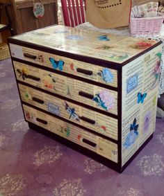 Vintage chest of drawers decoupaged with vintage sheet music and images courtesy of Graphic Fairy. By Home Revival Interiors