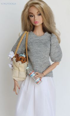 I love that she has a puppy in her purse. Like every woman should!!