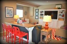 Fluff Interior Design - love the counter ht. dining behind the sofa and pops of bright color!