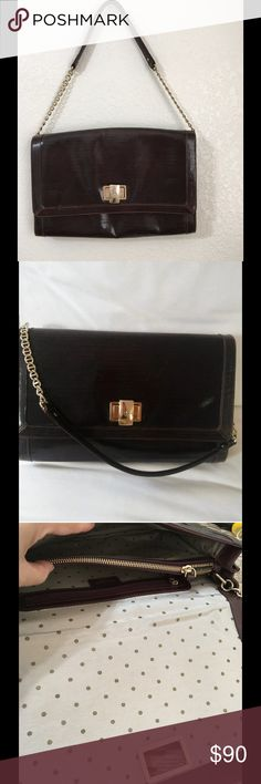 Vintage KATE SPADE burgundy handbag Gold clasp Does have some minor scratching, please see all photos bag measures 8.5 height x 2.5 d x 13 length.  This bag overall is in great condition.  If you love to collect Vintage Kate Spade this is a rare one!!! kate spade Bags Shoulder Bags