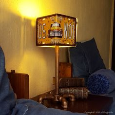 Make this easy DIY License Plate Lamp using plumbing bits and a license plate.