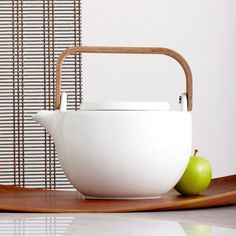 Chava Ceramic Teapot w/ Wooden Handle  A 42 fl oz white teapot with mahogany handle and interior tea strainer. $69.90 42.3 oz    http://websites-buy.com/starbucks-coffee-store
