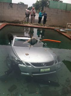 Picture of a Lexus submerged in a swimming pool. Oops!