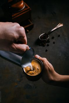 coffee barista Man pouring milk cream over a espresso coffee by VICTOR TORRES for Stocksy United Coffee Barista, Coffee Cafe, Coffee Drinks, Cozy Coffee, Coffee Milk, Coffee Shop Photography, Dark Food Photography, Coffee Shot, Chocolate Caliente
