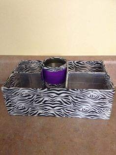 DIM (did it myself) locker organizer. I made it out of a shoe box, duct tape, and some cardboard. The pencil holder is a tin can!
