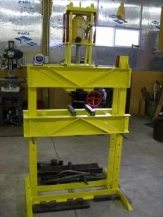 Shop Press - Homemade shop press constructed from reinforced channel iron and powered by a 32-ton hydraulic bottle jack. Features a rolling head.