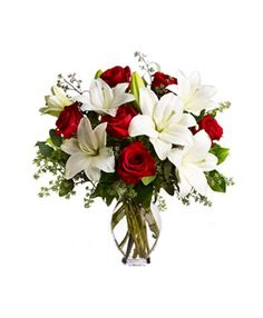 Beautiful bunch of 6 red roses and 3 white oriental lilies in a glass vase. only@Rs.1,399.00