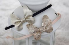 Thin hard headbands in black and champagne with handmade Gold leather butterflies. Perfect for photo shoots and every day wear!  The butterfly is 2 (5cm) wide and the headband is approximately 15 (37cm) from end to end. Recommended for ages 3T to adults.  The headbands are $8 each or $12 for the set. Ready to ship item. Ships within 1 business day.