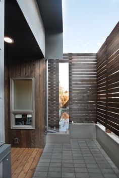 Love this screen....carport???? Lever Homes - modern - exterior - seattle - by First Lamp