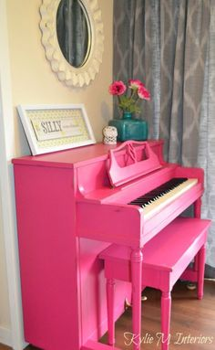 I love painting furniture!  This piano was painted with Benjamin Moore Pink Peony and then distressed