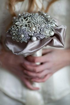 Brooch wedding bouquet with satin collar, $450 on Etsy.com from moonmaisie.