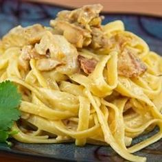 Bacon, shallots, onion and garlic, cooked in a thick creamy sauce, and tossed with fettuccini.