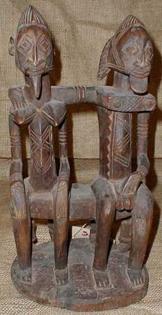 African Statues - Dogon Primordial Couple This Primordial couple is of wood, and…