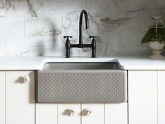 A tactile pattern on glossy cast iron makes this anything-but-traditional farmhouse sink a true design star.