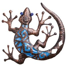 Artfully crafted of metal and glass, this charming lizard-shaped wall decor adds eclectic appeal with its blue hue and embossed finish.    ...