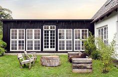 Scandinavian Home Design garden exterior, general inspiration, windows, dark wood with white trim, switch and have white siding with dark framed windows