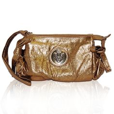 Gucci Gold Hysteria Clutch http://www.consignofthetimes.com/product_details.asp?galleryid=8233
