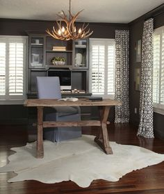 Shutters with dummy drapes on one side. Do this for the living room/dining room.