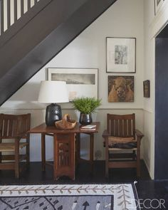 Art Nouveau drop-leaf table at home under the staircase.