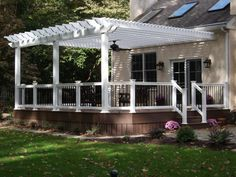 White Vinyl Pergola on an Azek Acacia deck